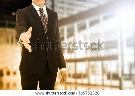 Businessman welcome handshake for good corporation business. - stock photo