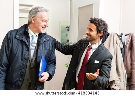 Businessman welcoming a colleague