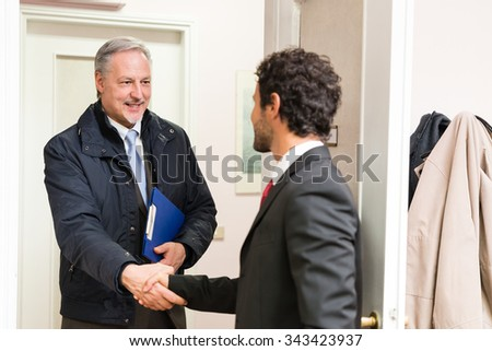 Businessman welcoming a guest in his office