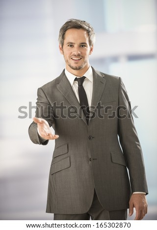 businessman welcoming someone
