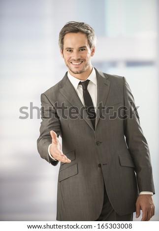businessman welcoming someone - stock photo