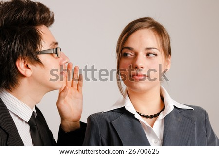 Businessman whispering to his partner - stock photo
