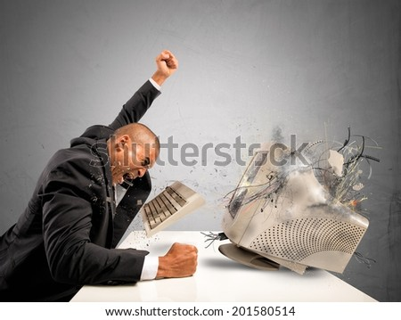 Businessman who breaks  furiously an old computer - stock photo