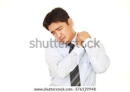 Businessman who has a shoulder pain.