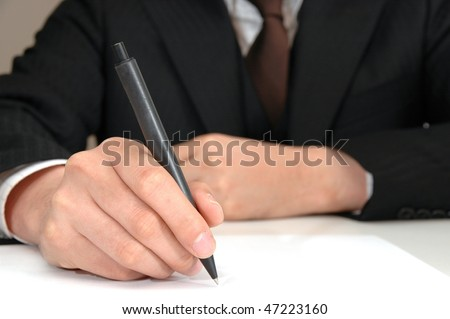 Businessman who takes notes
