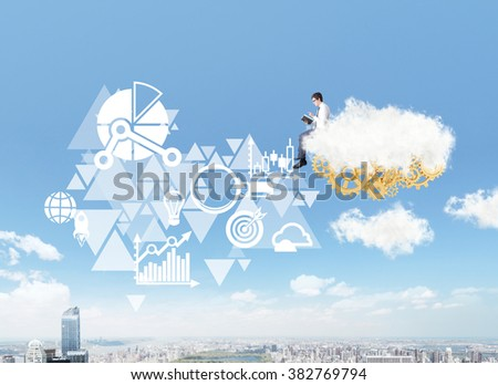 businessman with a book sitting on a cloud over New York, golden cogwheels under it, different business icons to left. Side view. Concept of dream and aspirations.