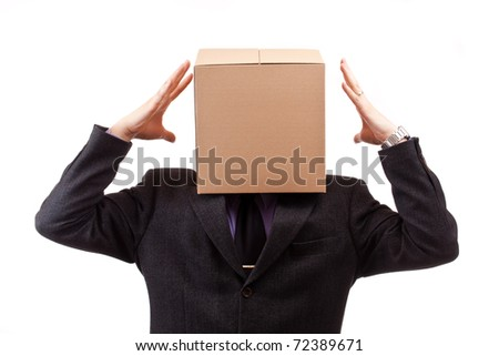 Businessman with a brown box on his head, isolated in white - stock photo