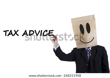 Businessman with a carton head writes tax advice on whiteboard, isolated on white - stock photo