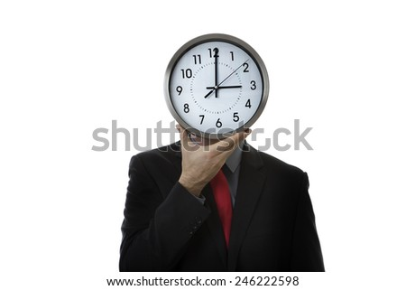 Businessman with a clock covering his face - stock photo