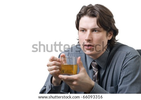 Businessman with a cup of tea against white background