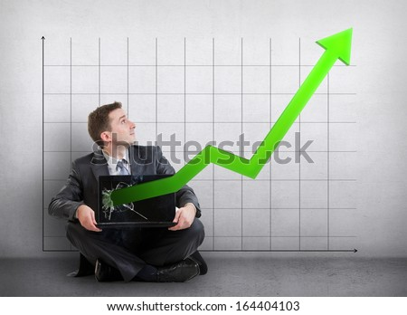 Businessman with a graph showing growth