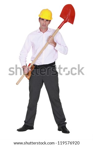 Businessman with a hardhat and shovel - stock photo