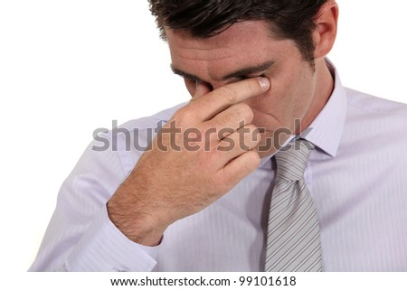 Businessman with a headache - stock photo