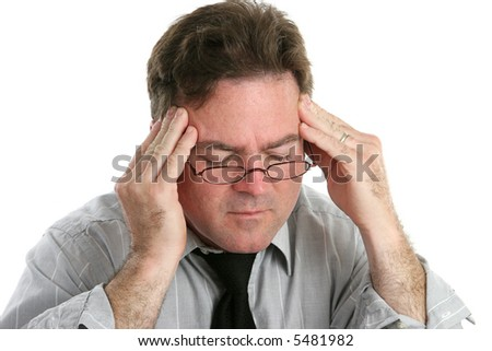Businessman with a headache rubbing his temples in pain.  Isolated on white.
