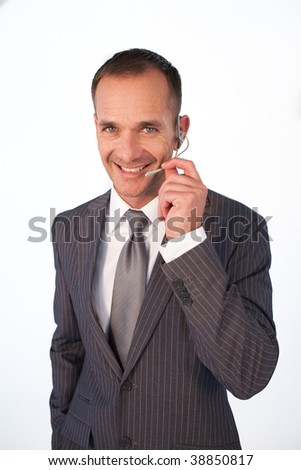 Businessman with a headset on talking to somebody