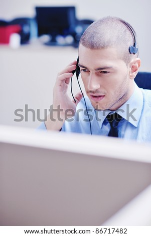 businessman with a headset portrait at bright call center helpdesk support office
