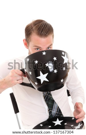 Businessman with a huge coffee cup. Wearing a white shirt and tie. White background. - stock photo