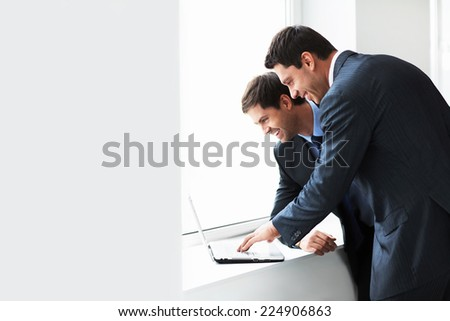 Businessman with a laptop by the window