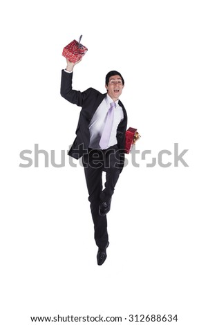 Businessman with a lot of gift packages (isolated in white) - stock photo