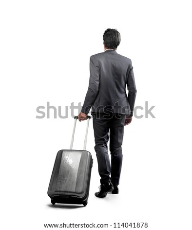 Businessman with a luggage - stock photo