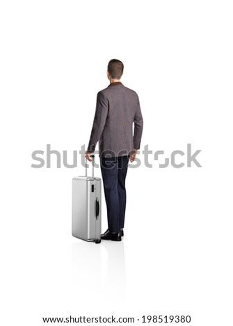 Businessman with a luggage isolated on white - stock photo