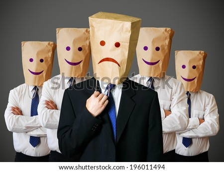 Businessman with a paper bag with sad face on the head - stock photo