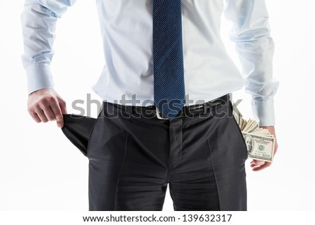 Businessman with a pocket full of money and an empty pocket