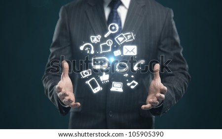 Businessman with a social media icon on his hands - stock photo