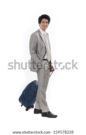 Businessman with a suitcase - stock photo