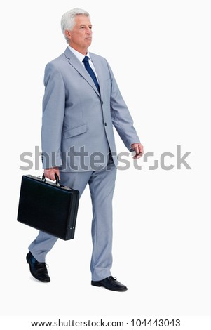 Businessman with a suitcase walking against white background