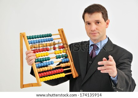 Businessman With Abacus - stock photo