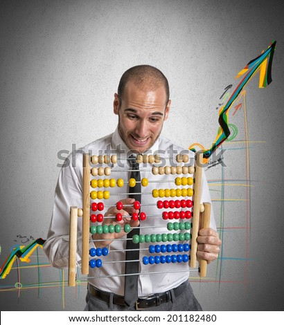 Businessman with abacus calculates a positive trend - stock photo