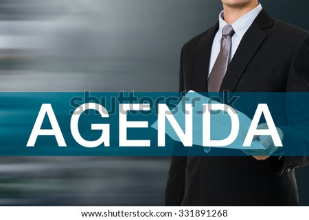 Businessman with AGENDA Word - stock photo