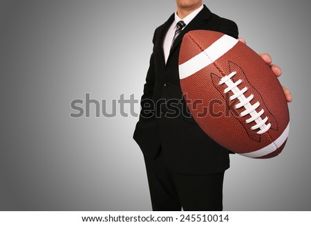 Businessman with American Football Ball - stock photo