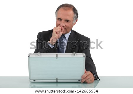 Businessman with an aluminum case