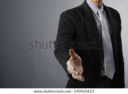 businessman with an open hand ready to seal