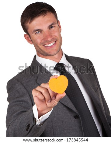 businessman with an orange heart in hand on Valentine's Day - stock photo