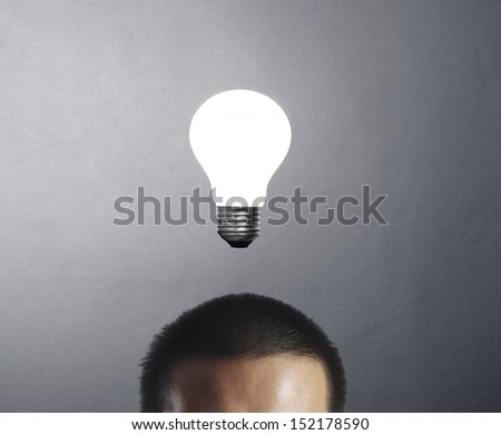 Businessman with and idea, drawn light bulb  - stock photo