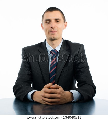 Businessman with Arms Crossed On the table