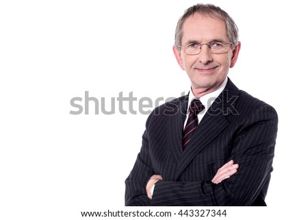 Businessman with arms folded looking at the camera.