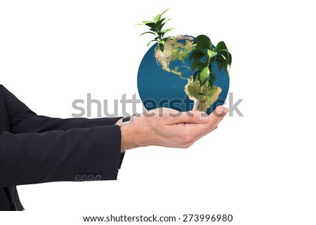 Businessman with arms out presenting something against little green seedling with leaves growing - stock photo