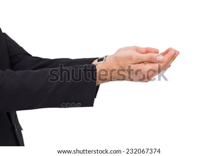 Businessman with arms out presenting something n white bakcground