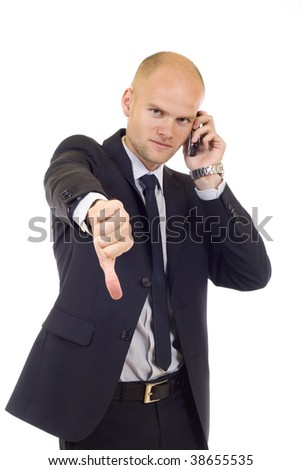 Businessman with bad news on his cell phone disapproving