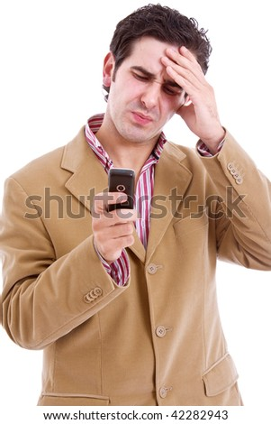 Businessman with bad news on his cell phone, isolated on white - stock photo