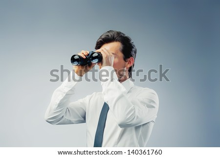 businessman with binocular copy space - stock photo