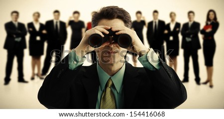 Businessman with binoculars. Job search concept background. - stock photo