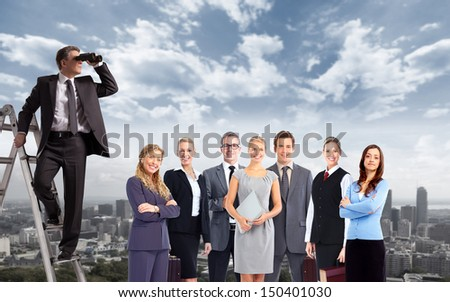 Businessman with binoculars spying on competitors. - stock photo