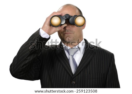 Businessman with binoculars watching