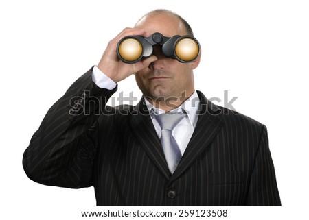 Businessman with binoculars watching - stock photo