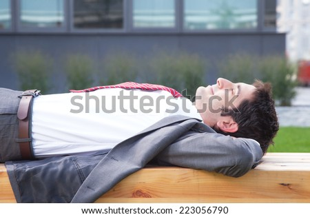 Businessman with black hair relaxing outside - stock photo